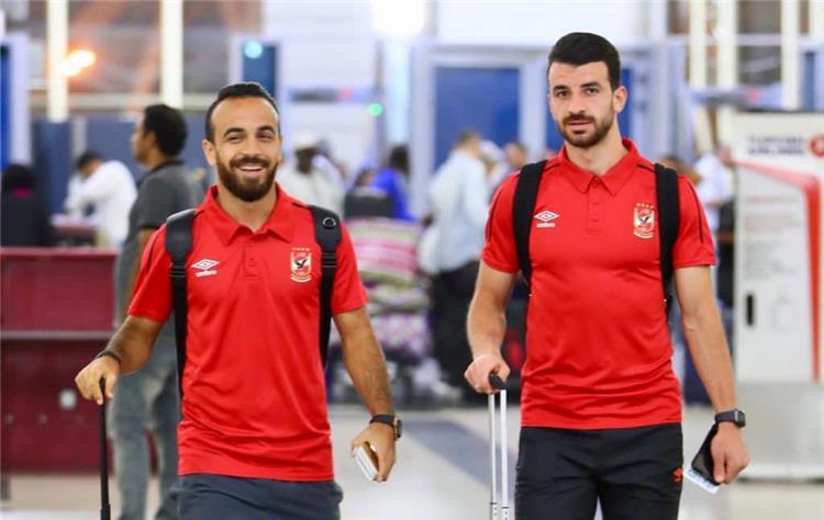 أفشة ومتولي لاعبا الأهلي في مطار القاهرة
