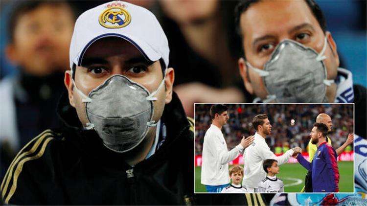 مشجعو ريال مدريد بالكمامات خوف ا من كورونا